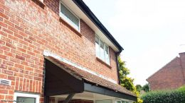 Black UPVC cladding and fascia with white UPVC soffit
