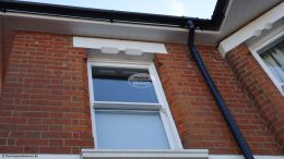 White hollow soffit, white ogee UPVC fascia with black UPVC guttering