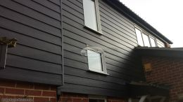 Black hardieplank cladding with black ash fascias soffits