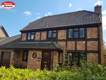 Rosewood fascias soffits with brown round gutters installation