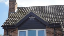 Installation of new black ash fascias soffits guttering cladding