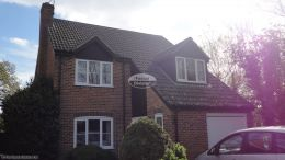 Installation of black ash fascias, soffits, guttering and cladding