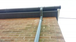 Installation of custom coloured grey soffits and downpipes