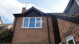 Recent full replacement of black ash fascias and soffits with black guttering