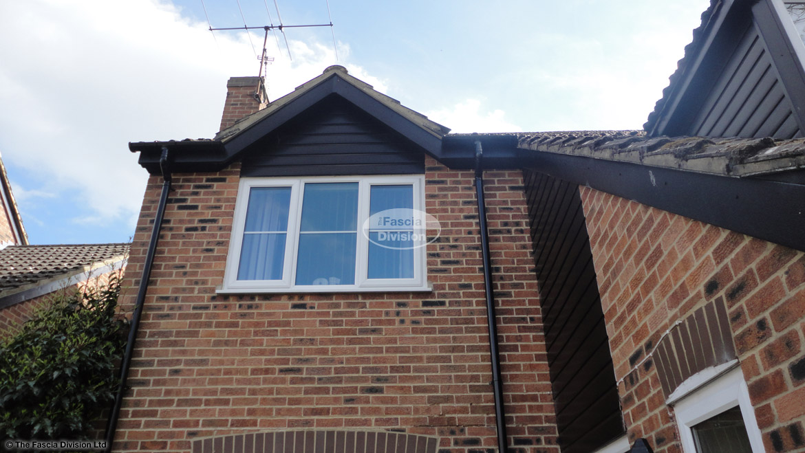 Installation New Black Ash Fascias Soffits Guttering And