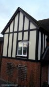 Replica oak mock tudor beam installation with cream composite render panels