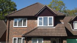 Rosewood UPVC shiplap cladding fascias and soffits with UPVC brown guttering