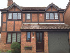 Replica wood oak tudor beams and fascia soffit guttering full installation