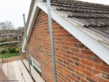 Re-point roof tiles and replace fascia, soffit and guttering