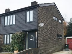Black cladding, fascias, soffits and guttering