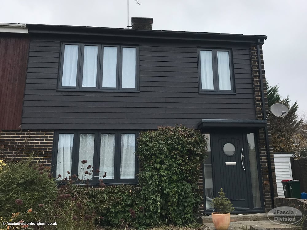black fascias, soffits, guttering and cladding