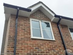 white fascias and soffits with black guttering