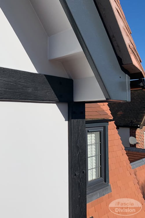 Grey fascias with white soffits and black mock Tudor boards